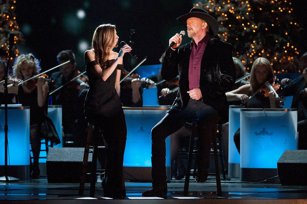 Description of . Lily Costner and Trace Adkins perform during the CMA 2013 Country Christmas on November 8, 2013 in Nashville, Tennessee.  (Photo by Erika Goldring/Getty Images)