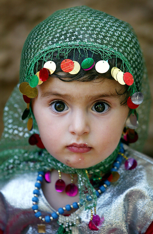 Description of . A Kurdish girl, Leiwan, 2, attends a traditional wedding celebration June 15, 2003 in Bakochek, Iraq. Saddam Hussein\'s regime killed an estimated 180,000 Kurds from 1988-1991 in a genocidal campaign involving both chemical and conventional weapons. (Photo by Mario Tama/Getty Images)