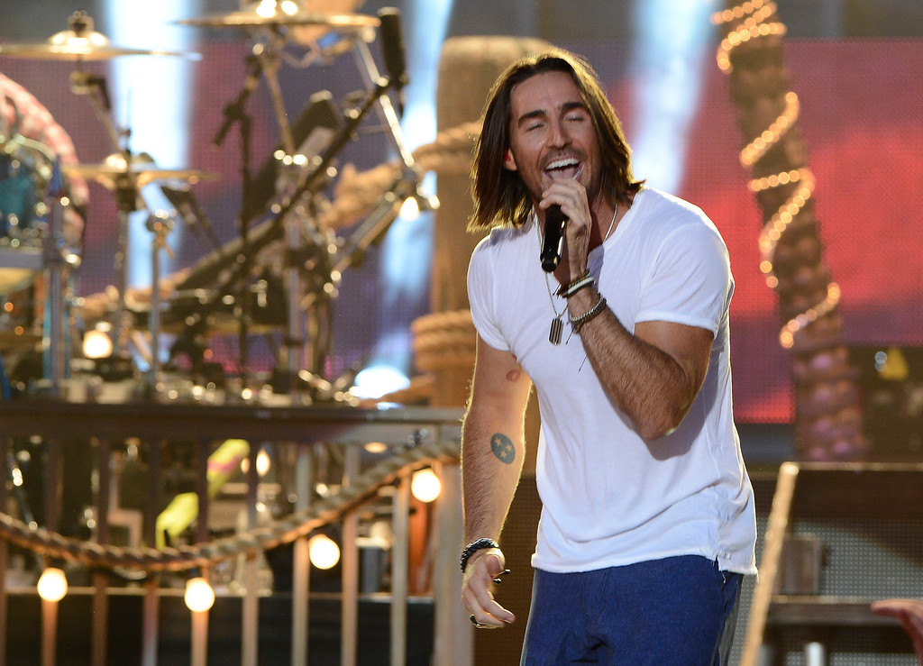Description of . Jake Owen performs on an outdoor stage during the CMT Music Awards on Wednesday, June 4, 2014, in Nashville, Tenn.  (Photo by Mark Zaleski/Invision/AP)