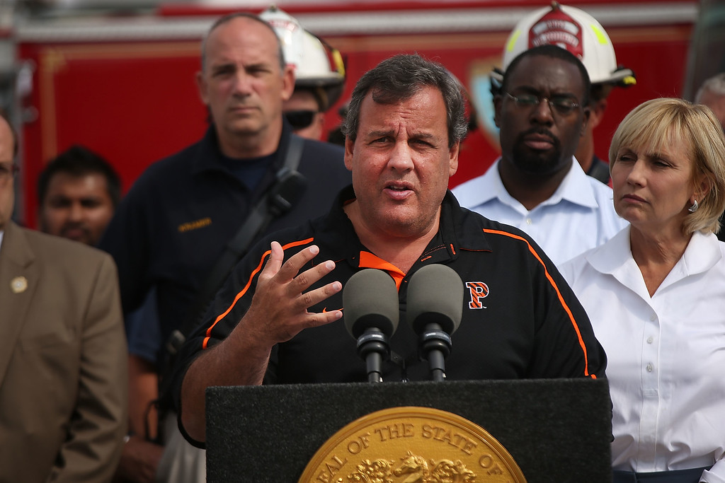 Description of . New Jersey Gov. Chris Christie (C) speaks to the media at the scene of a massive fire that destroyed dozens of businesses along an iconic Jersey shore boardwalk on September 13, 2013 in Seaside Heights, New Jersey.  (Photo by Spencer Platt/Getty Images)