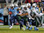 NASHVILLE, TN - DECEMBER 17:  Chris Johnson #28 of the Tennessee Titans breaks through the defense of the New York Jets for a 94 yard touchdown rush at LP Field on December 17, 2012 in Nashville, Tennessee.  (Photo by Frederick Breedon/Getty Images)