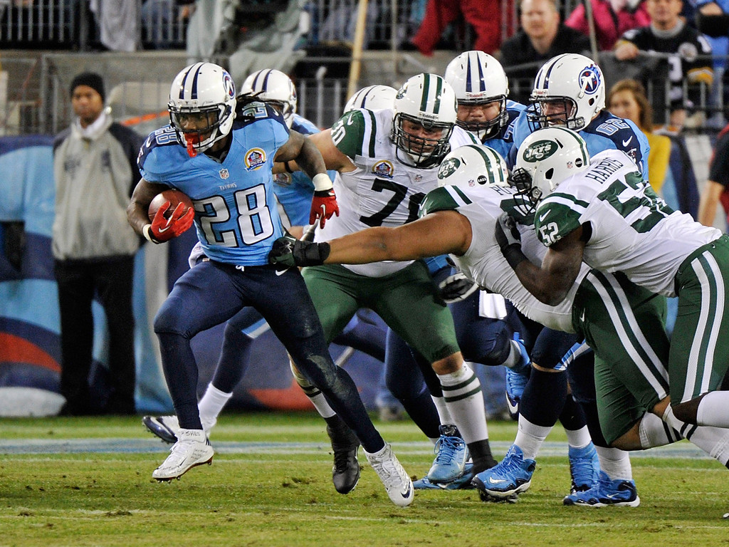 Description of . NASHVILLE, TN - DECEMBER 17:  Chris Johnson #28 of the Tennessee Titans breaks through the defense of the New York Jets for a 94 yard touchdown rush at LP Field on December 17, 2012 in Nashville, Tennessee.  (Photo by Frederick Breedon/Getty Images)