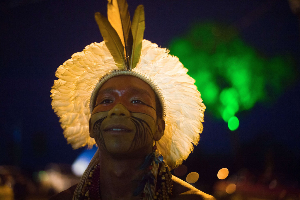 Description of . A Brazilian indigenous man of the Pataxo tribe is seen after the bow and arrow competition during the XII International Games of Indigenous Peoples in Cuiaba, Mato Grosso state, Brazil on November 12, 2013. AFP PHOTO / Christophe SIMON/AFP/Getty Images