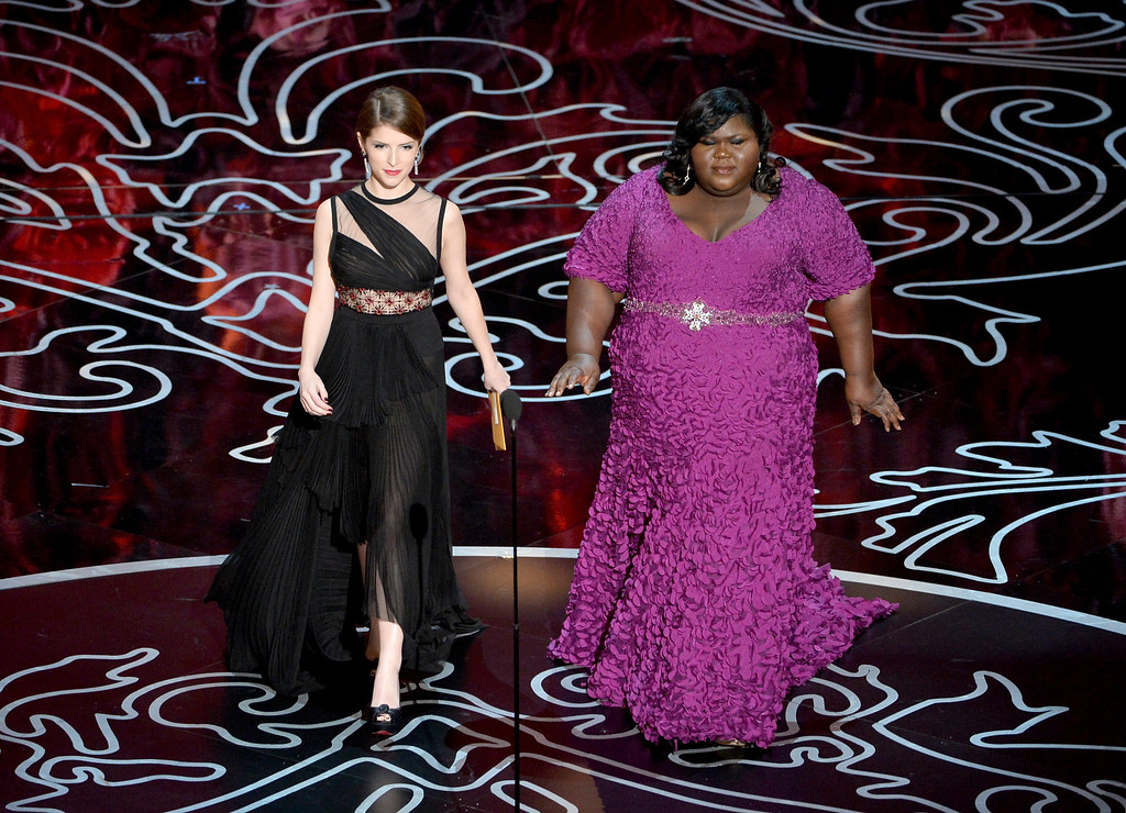 Description of . Actresses Anna Kendrick (L) and Gabourey Sidibe speak onstage during the Oscars at the Dolby Theatre on March 2, 2014 in Hollywood, California.  (Photo by Kevin Winter/Getty Images)