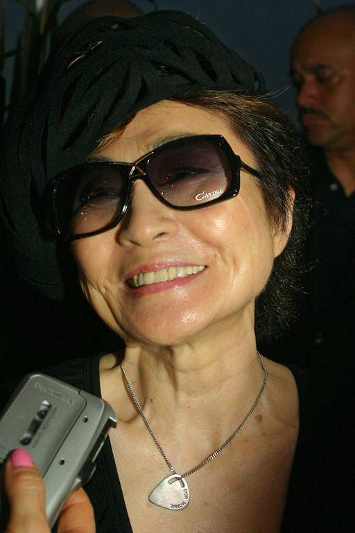 Description of . Yoko Ono arrives for the New York Restoration Project opening ceremony of the Peter Jay Sharp Boathouse on the Harlem River and the opening of Swindler Cove Park Thursday, June 17, 2004, in New York.  (AP Photo/Tina Fineberg)