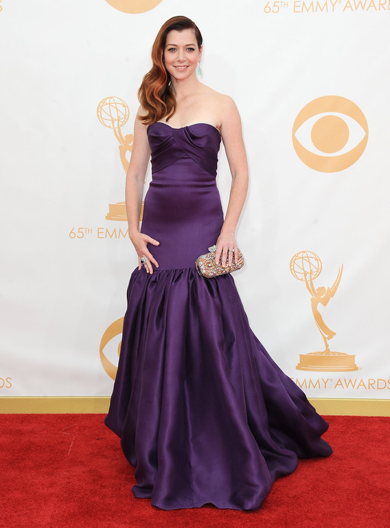 Description of . Alyson Hannigan arrives at the 65th Primetime Emmy Awards at Nokia Theatre on Sunday Sept. 22, 2013, in Los Angeles.  (Photo by Jordan Strauss/Invision/AP)