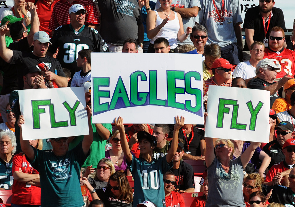 Description of . TAMPA, FL - DECEMBER 9: Fans of the Philadelphia Eagles cheer play against the Tampa Bay Buccaneers  December 9, 2012 at Raymond James Stadium in Tampa, Florida. (The Eagles won 2 - 21. Photo by Al Messerschmidt/Getty Images)