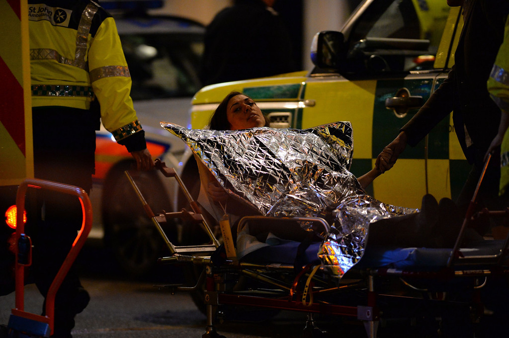 . An injured woman is taken towards a waiting ambulance on a stretcher following a ceiling collapse at a theatre in Central London on December 19, 2013.   AFP PHOTO/LEON NEAL/AFP/Getty Images