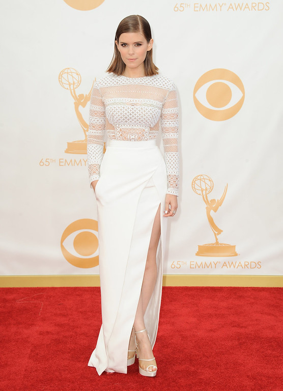 Description of . Kate Mara arrives at the 65th Primetime Emmy Awards at Nokia Theatre on Sunday Sept. 22, 2013, in Los Angeles.  (Photo by Jordan Strauss/Invision/AP)