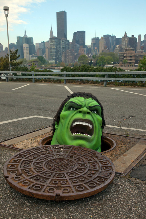 Description of . The Hulk from Madame Tussauds New York peers out of a manhole at the Con Ed Learning Center in Queens, New York on Thursday, April 19, 2012. The interactive Marvel Super Heroes Experience opens at Madame Tussauds New York on Thursday, April 26. Photo taken by newscast for Madame Tussauds.(Jim Sulley/newscast)