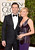 Actor Jon Hamm (L) and actress-filmmaker Jennifer Westfeldt arrive at the 70th Annual Golden Globe Awards held at The Beverly Hilton Hotel on January 13, 2013 in Beverly Hills, California.  (Photo by Jason Merritt/Getty Images)