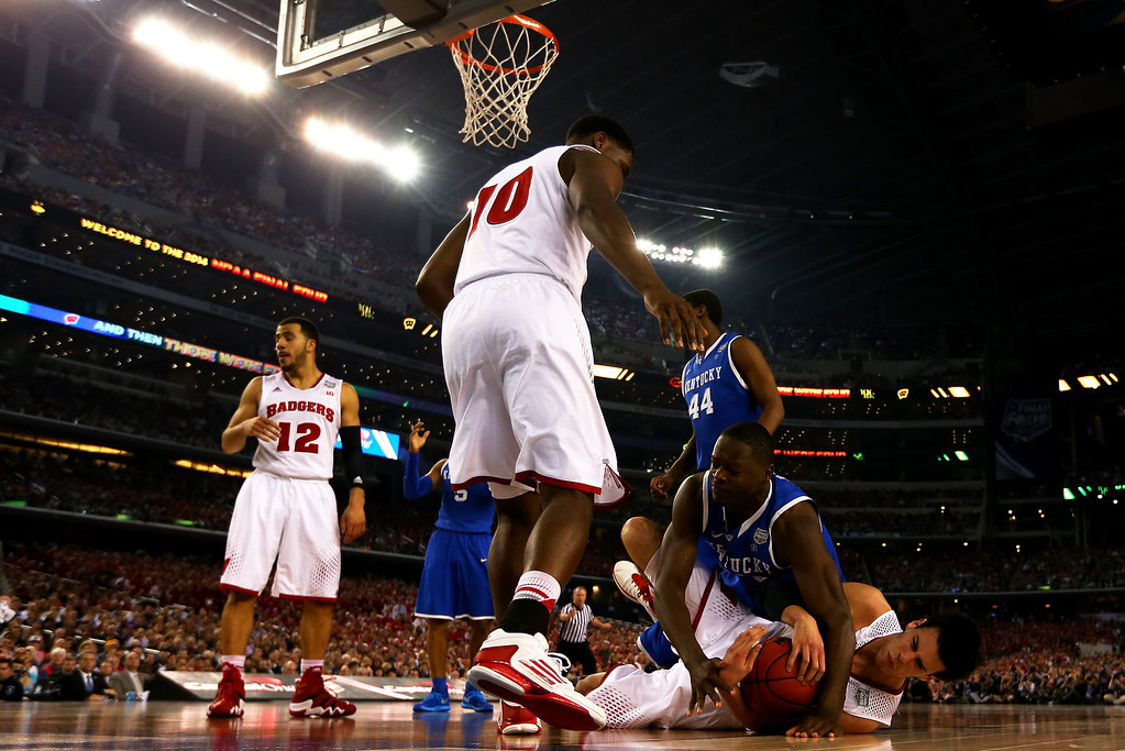 Description of . ARLINGTON, TX - APRIL 05:  Julius Randle #30 of the Kentucky Wildcats and Duje Dukan #13 of the Wisconsin Badgers battle for a rebound during the NCAA Men's Final Four Semifinal at AT&T Stadium on April 5, 2014 in Arlington, Texas.  (Photo by Jamie Squire/Getty Images)