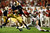 Notre Dame Fighting Irish quarterback Everett Golson is grabbed by Alabama Crimson Tide defensive back Vinnie Sunseri during the second quarter of their NCAA BCS National Championship college football game in Miami, Florida, January 7, 2013. REUTERS/Mike Segar