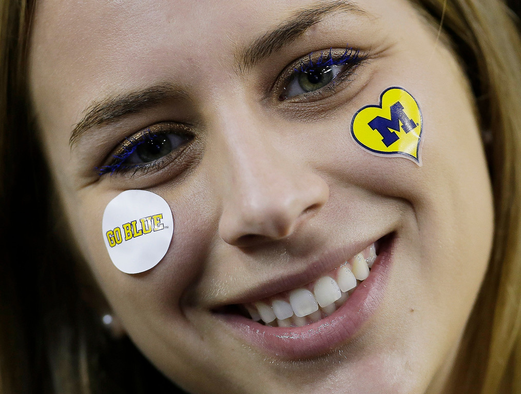 . Michigan fan Abby Lieberman cheers before the first half of the NCAA Final Four tournament college basketball championship game against the Louisville, Monday, April 8, 2013, in Atlanta. (AP Photo/Charlie Neibergall)