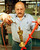 Nunzio Giganti uses a compressed air sprayer to dry an Oscar statuette after pulling it from a gold-plating solution at R.S. Owens in Chicago, Illinois, 02 February. The statuettes are cast, polished and plated with copper, nickel, silver and then gold in preparation for the upcoming Academy Awards to be presented in Los Angeles 21 March.   JOHN ZICH/AFP/Getty Images