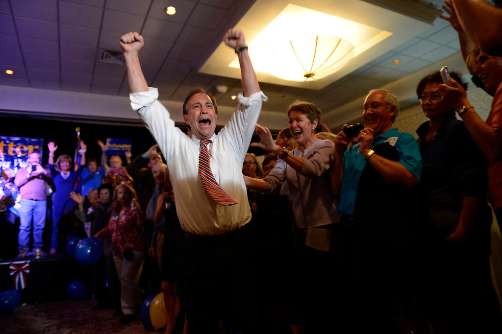 Description of . Rep. Ed Perlmutter cheers with the crowd after doing a double cartwheel after winning over Joe Coors Jr. at the Sheraton Denver west Lakewood, Colorado Tuesday,  November 06,  2012.