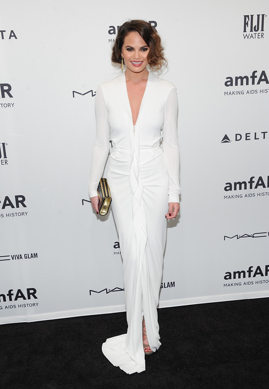 Description of . Model Chrissy Teigen attends amfAR's New York gala at Cipriani Wall Street on Wednesday, Feb. 6, 2013 in New York. (Photo by Evan Agostini/Invision/AP)