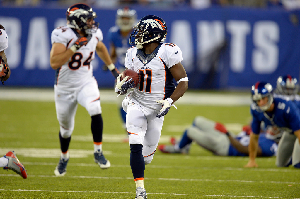Description of . Denver Broncos wide receiver Trindon Holliday (11) looks back as he out runs the New York Giants special teams on an 81 yard punt return for a touchdown during the fourth quarter September 15, 2013 MetLife Stadium. (Photo by John Leyba/The Denver Post)