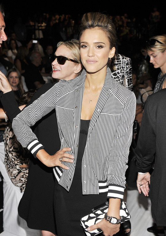 Description of . Jessica Alba attends the Diane Von Furstenberg fashion show during Mercedes-Benz Fashion Week Spring 2014 at The Theatre at Lincoln Center on September 8, 2013 in New York City.  (Photo by Stephen Lovekin/Getty Images for Mercedes-Benz Fashion Week Spring 2014)
