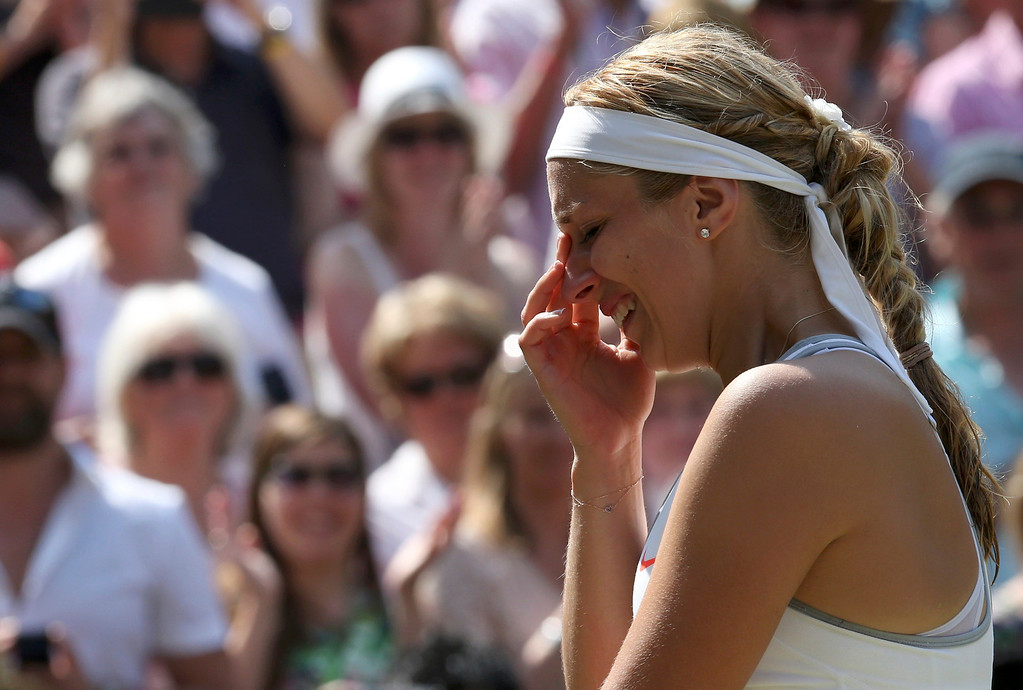 Description of . Sabine Lisicki of Germany cries as she is interviewed on Centre Court after being defeated by Marion Bartoli of France in their women's singles final tennis match at the Wimbledon Tennis Championships, in London July 6, 2013.         REUTERS/Suzanne Plunkett