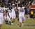 Navy players Pablo Beltran (11) and Wes Henderson (99) celebrate a win over Army at the conclusion of the Army versus Navy NCAA football game in Philadelphia, Pennsylvania, December 8, 2012. REUTERS/Tim Shaffer