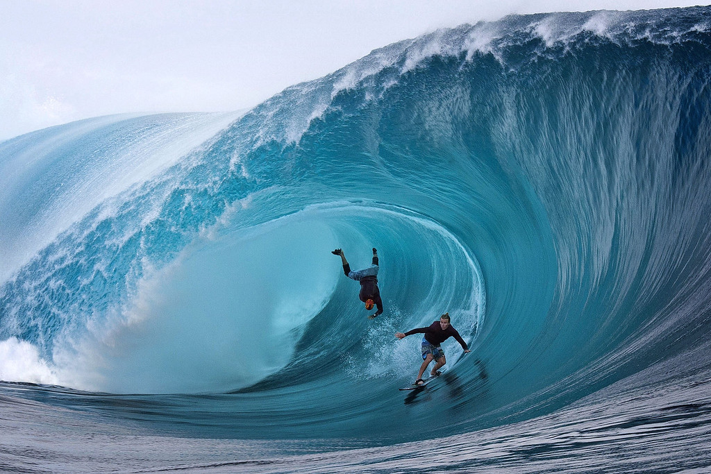 Description of . U.S. surfers Garrett McNamara (L) and Mark Healey (R) compete during a free session of surf tow in, in the southern Pacific ocean island of Tahiti, French Polynesia, on June 1, 2013 in Teahupoo.   GREGORY BOISSY/AFP/Getty Images