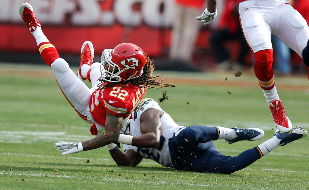Description of . Kansas City Chiefs wide receiver Dexter McCluster (22) is tackled by San Diego Chargers cornerback Shareece Wright (29) during the first half of an NFL football game in Kansas City, Mo., Sunday, Nov. 24, 2013. (AP Photo/Ed Zurga)