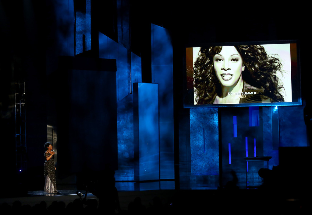 Description of . Gladys Knight performs during an in memoriam as an image of Donna Summer is projected onscreen at the 44th Annual NAACP Image Awards at the Shrine Auditorium in Los Angeles on Friday, Feb. 1, 2013. (Photo by Matt Sayles/Invision/AP)