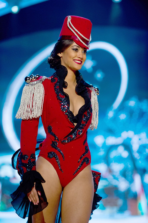 Description of . Miss Switzerland 2012, Alina Buchschacher, performs onstage at the 2012 Miss Universe National Costume Show on Friday, Dec. 14, 2012 at PH Live in Las Vegas, Nevada. The 89 Miss Universe Contestants will compete for the Diamond Nexus Crown on Dec. 19, 2012. (AP Photo/Miss Universe Organization L.P., LLLP)
