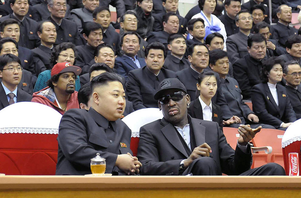 Description of . North Korean leader Kim Jong-Un (front L) and former NBA star Dennis Rodman (front R) speak to each other during a basketball game in Pyongyang. Flamboyant former NBA star Dennis Rodman has become the most high-profile American to meet the new leader of North Korea, vowing eternal friendship with Kim Jong-Un. KCNA/AFP/Getty Images