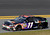 Denny Hamlin, driver of the #11 FedEx Express Toyota, drives down the aprin after an incident in the NASCAR Sprint Cup Series Budweiser Duel 1 at Daytona International Speedway on February 21, 2013 in Daytona Beach, Florida.  (Photo by Matthew Stockman/Getty Images)