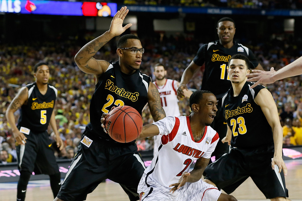 Description of . ATLANTA, GA - APRIL 06:  Russ Smith #2 of the Louisville Cardinals with the ball against Carl Hall #22, Fred VanVleet #23 and Ron Baker #31 of the Wichita State Shockers in the second half during the 2013 NCAA Men's Final Four Semifinal at the Georgia Dome on April 6, 2013 in Atlanta, Georgia.  (Photo by Kevin C. Cox/Getty Images)