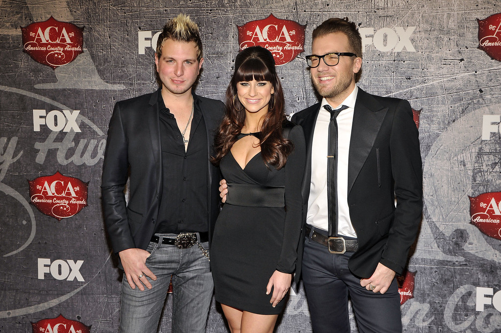 Description of . From left, Mike Gossin, Rachel Reinert and Tom Gossin of Gloriana arrive at the American Country Awards on Monday, Dec. 10, 2012, in Las Vegas. (Photo by Jeff Bottari/Invision/AP)