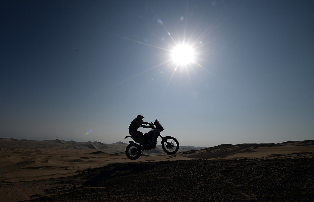 Description of . Sherco's rider Alain Duclos jumps during Stage 3 of the Dakar Rally 2013 between Pisco and Nazca, Peru, on January 7, 2013. The rally will take place in Peru, Argentina and Chile from January 5-20.  FRANCK FIFE/AFP/Getty Images