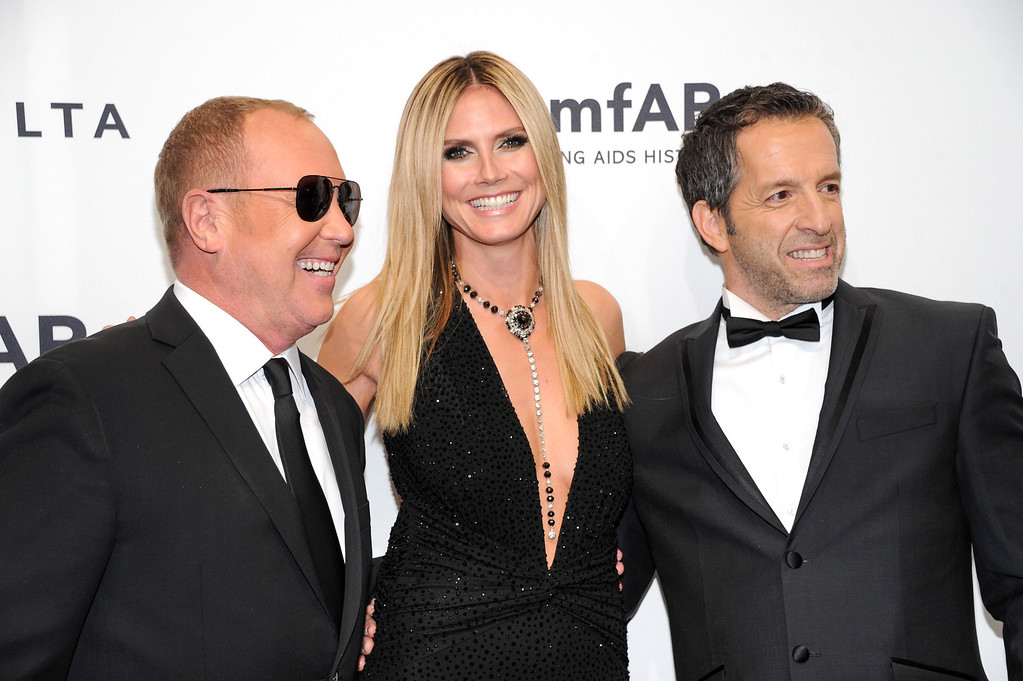Description of . Designer Michael Kors, left, poses with honorees Heidi Klum and Kenneth Cole at amfAR's New York gala at Cipriani Wall Street on Wednesday, Feb. 6, 2013 in New York. (Photo by Evan Agostini/Invision/AP)