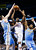 Oklahoma City Thunder forward Kevin Durant (35) shoots between Denver Nuggets center Kosta Koufos (41) and guard Andre Iguodala (9) in the third quarter of an NBA basketball game in Oklahoma City, Tuesday, March 19, 2013. Denver won 114-104. (AP Photo/Sue Ogrocki)