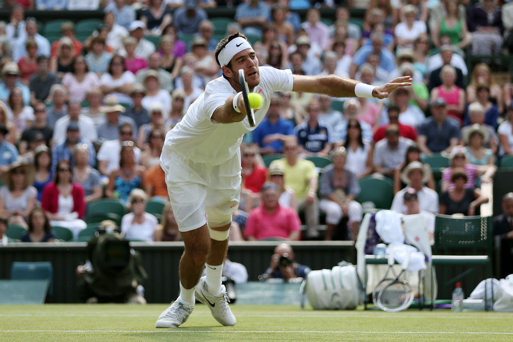Description of . LONDON, ENGLAND - JULY 05:  Juan Martin Del Potro of Argentina dives to volley the ball during the Gentlemen\'s Singles semi-final match against Novak Djokovic of Serbia on day eleven of the Wimbledon Lawn Tennis Championships at the All England Lawn Tennis and Croquet Club on July 5, 2013 in London, England.  (Photo by Clive Brunskill/Getty Images)