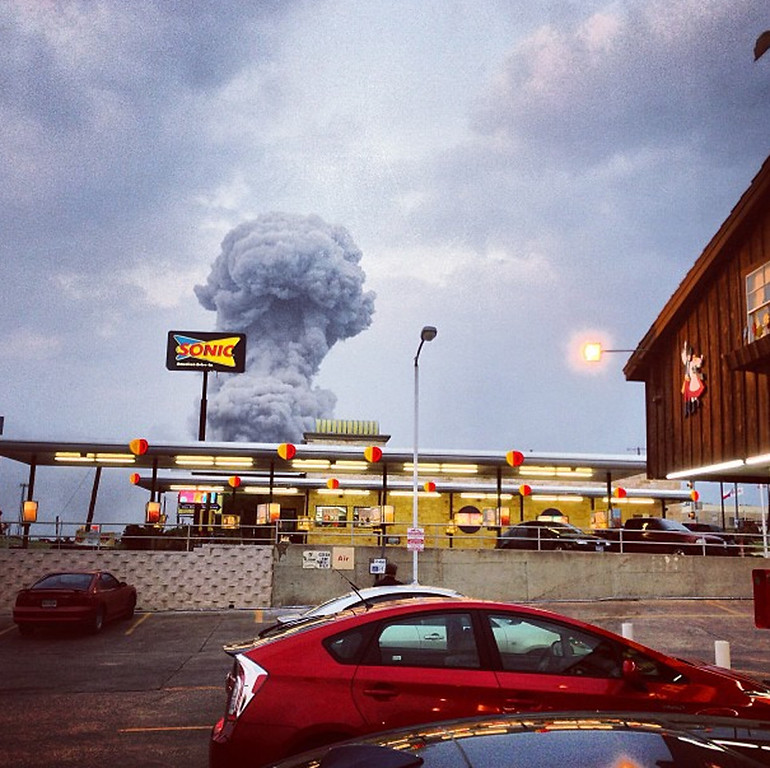 Description of . In this Instagram photo provided by Andy Bartee, a plume of smoke rises from a fertilizer plant fire in West, Texas on Wednesday, April 17, 2013.  An explosion at a fertilizer plant near Waco Wednesday night injured dozens of people and sent flames shooting high into the night sky, leaving the factory a smoldering ruin and causing major damage to surrounding buildings. (AP Photo/Andy Bartee)