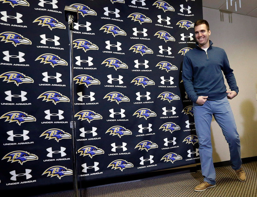 Description of . Baltimore Ravens quarterback Joe Flacco walks up to a microphone before speaking at a news conference at the team's practice facility in Owings Mills, Md., Monday, March 4, 2013. Flacco agreed to a contract that will make him the richest quarterback in NFL history after leading the Ravens to a Super Bowl XLVII victory over the San Francisco 49ers. (AP Photo/Patrick Semansky)