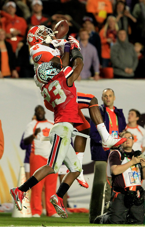 Description of . MIAMI GARDENS, FL - JANUARY 03: Mike Williams #7 of the Clemson Tigers fails to catch a ball against Tyvis Powell #23 of the Ohio State Buckeyes in the third quarter during the Discover Orange Bowl at Sun Life Stadium on January 3, 2014 in Miami Gardens, Florida.  (Photo by Chris Trotman/Getty Images)