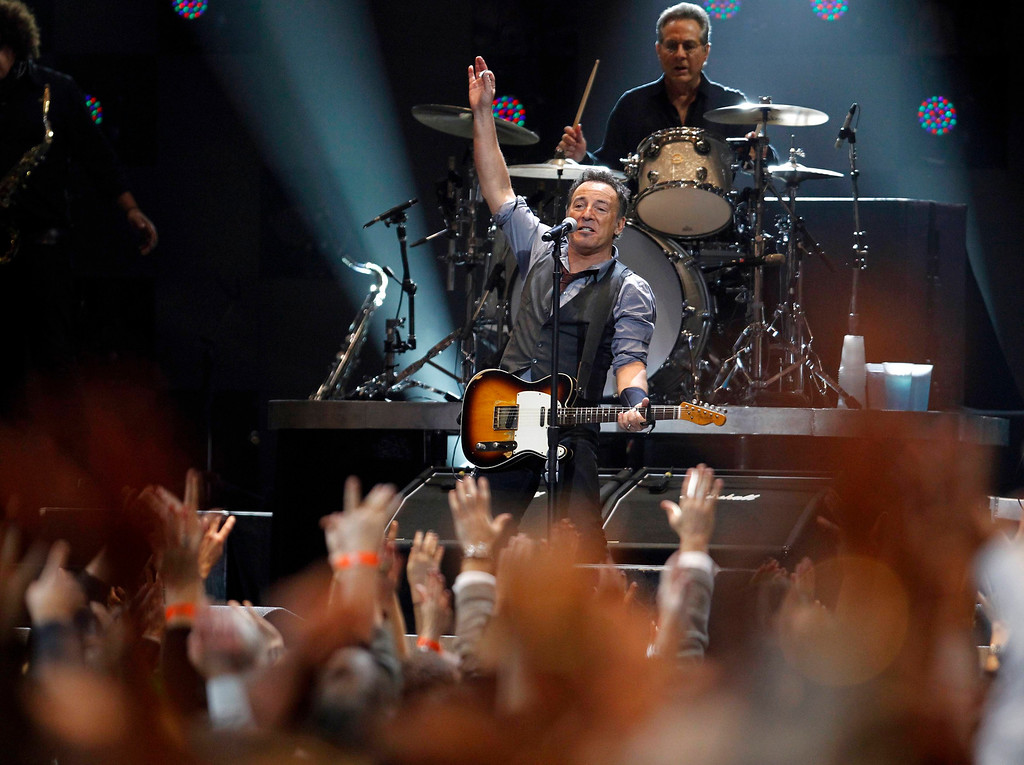 Description of . Bruce Springsteen performs with drummer Max Weinberg (top) of E Street Band during the