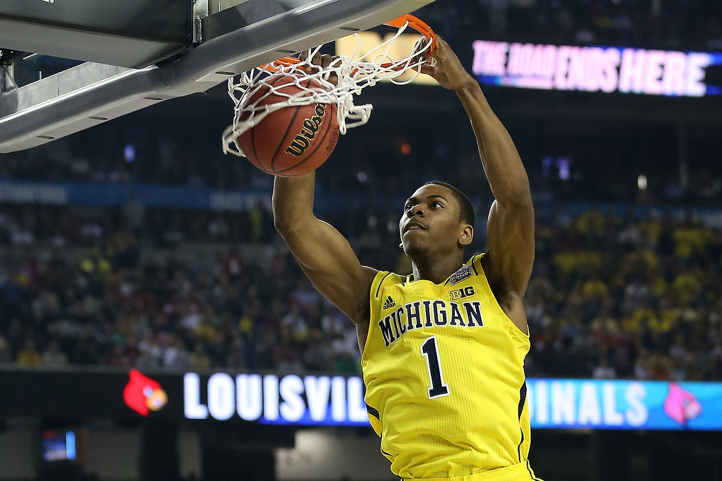 Description of . Glenn Robinson III #1 of the Michigan Wolverines dunks in the first half against the Louisville Cardinals during the 2013 NCAA Men\'s Final Four Championship at the Georgia Dome on April 8, 2013 in Atlanta, Georgia.  (Photo by Streeter Lecka/Getty Images)