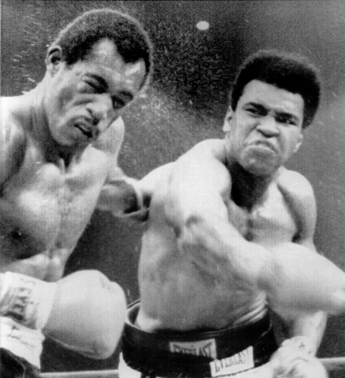 Description of . Muhammad Ali scores with a hard right to the head of Ken Norton. The former heavyweight champion wiped out the stain of a broken Jaw upset loss to ken Norton 5 ½  months ago by scoring a split decision in the 12-round rematch.	1973. Denver Post Library photo archive