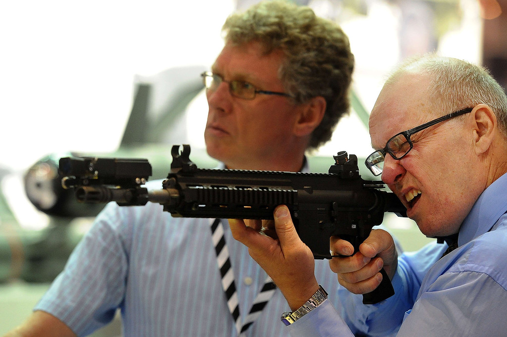 Description of . Weaponry is displayed at the Defense and Security Equipment International (DSEI) arms fair at the ExCeL centre in east London, on September 10, 2013.   AFP PHOTO / BEN  STANSALL/AFP/Getty Images