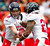 Denver Broncos quarterback Peyton Manning (18) hands off the football to Houston Texans running back Arian Foster (23) of the AFC in the first quarter of the NFL football Pro Bowl game against the NFC in Honolulu, Sunday, Jan. 27, 2013. (AP Photo/Eugene Tanner)