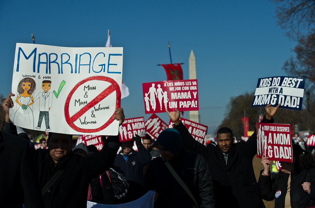 Description of . Opponents of same-sex marriage participate in the March for Marriage in Washington,DC on March 26, 2013 as the US Supreme Court hears arguments on California\'s Proposition 8 ban on same-sex marriage.    AFP PHOTO/Nicholas KAMM/AFP/Getty Images
