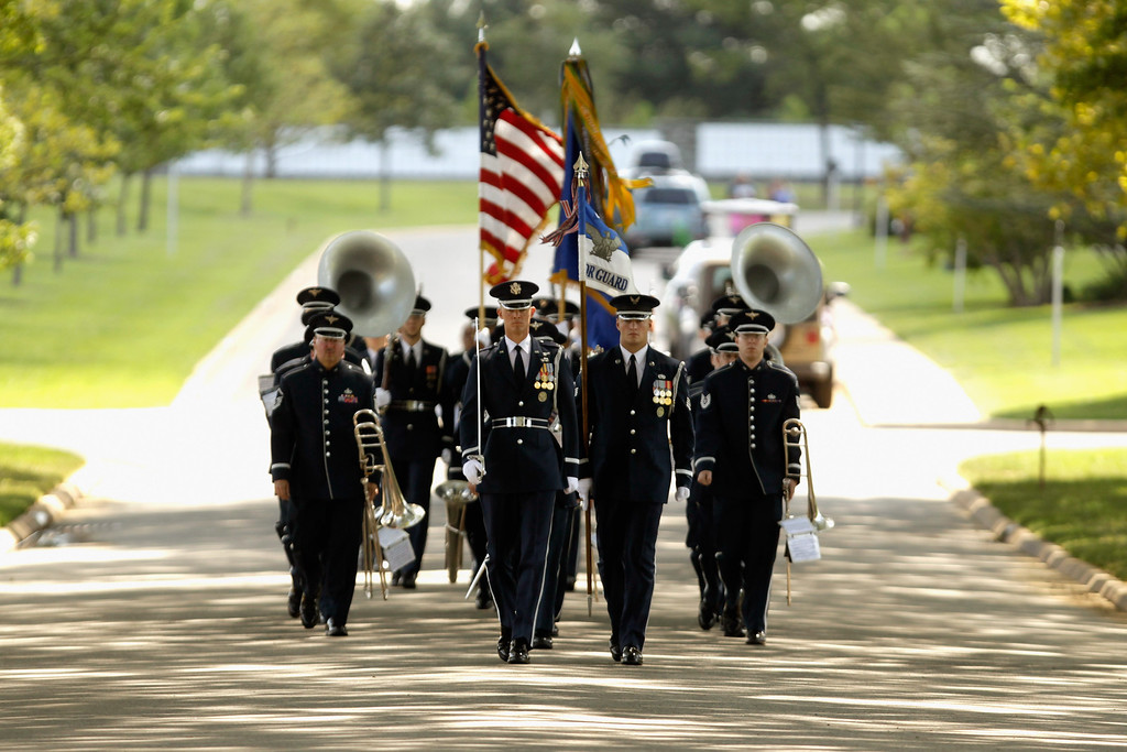 Description of . A U.S. Air Force Honor Guard leads members of the U.S. Air Force Band at the beginning of Captain David Anthony Wisniewski\'s burial service at Arlington National Cemetery August 23, 2010 in Arlington, Virginia. Originally from Moville, Iowa, the Air Force captain, 31, was the pilot of a Black Hawk helicopter that was shot down during a rescue mission in Afghanistan on June 9 and died of his injuries on July 2. Wisniewski is credited with saving more than 240 soldiers in seven tours of duty in Iraq and Afghanistan, 40 of which were saved in his final rescue mission in June. He was awarded the Purple Heart on June 23.  (Photo by Chip Somodevilla/Getty Images)