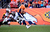 Denver Broncos tight end Jacob Tamme #84 tries to break a tackle from Tampa Bay Buccaneers strong safety Mark Barron #24.  The Denver Broncos vs The Tampa Bay Buccaneers at Sports Authority Field Sunday December 2, 2012. AAron  Ontiveroz, The Denver Post