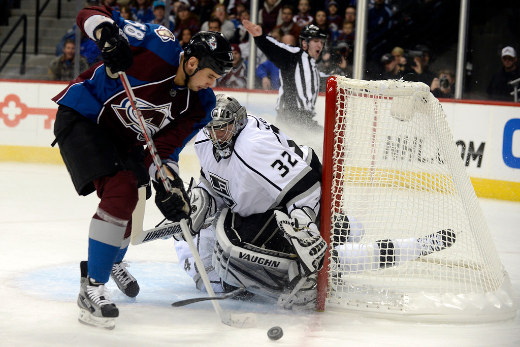 Description of . DENVER, CO. - JANUARY 22: Colorado Avalanche left wing Patrick Bordeleau (58) works the puck as Los Angeles Kings goalie Jonathan Quick (32) defends the net during the first period. The Colorado Avalanche hosted the Los Angeles Kings at the Pepsi Center on January, 22, 2013.   (Photo By John Leyba / The Denver Post)