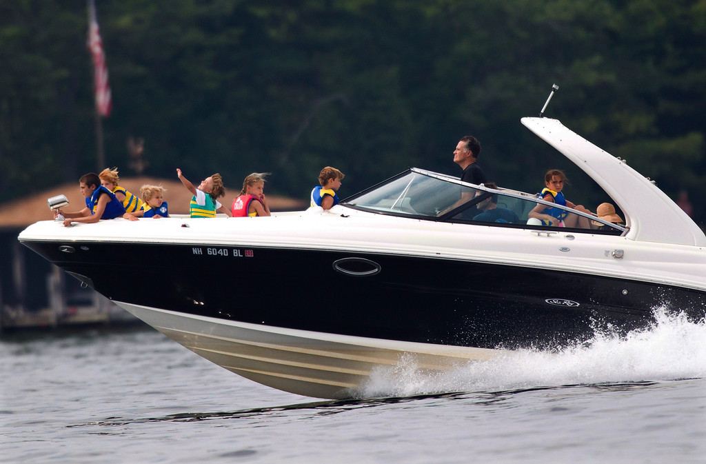 Description of . In this July 14, 2012 file photo, Republican presidential candidate, former Massachusetts Gov. Mitt Romney, takes his family for a boat ride on Lake Winnipesaukee in Wolfeboro, N.H.  (AP Photo/Evan Vucci, File)